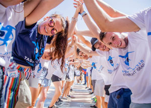 Birthright Israel participants forming a tunnel with their arms