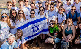 A Birthright Israel group holding up an Israeli flag