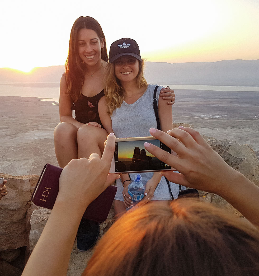 Taking a photo of a couple of Birthright Israel participants at sunrise on Masada