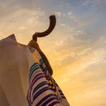 A man blowing the shofar on Rosh Hashanah